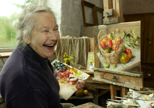 Anne Cotterill painting in her studio.